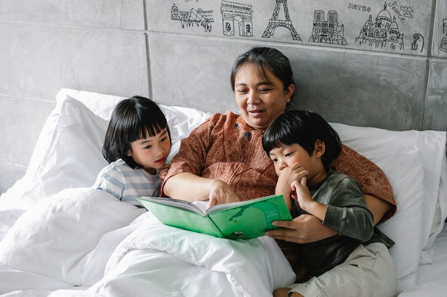 Grand Parents reading stories to children